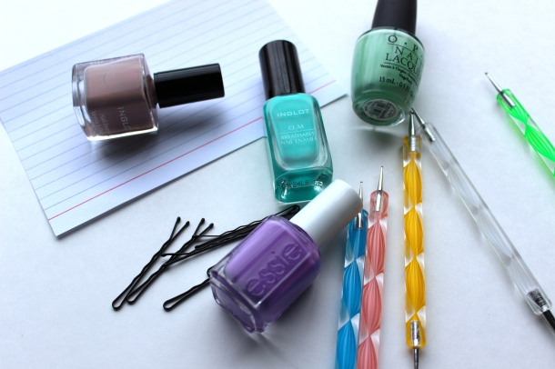 Nail polish, bobby pins, index card, dotting tools